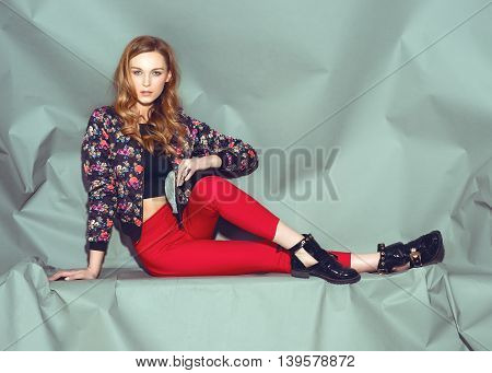 Fashion young woman street style pose on light gray background