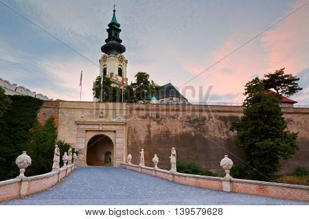 NITRA, SLOVAKIA - JULY 02, 2016: Nitra castle and cathedral at sunset on July 02, 2016.