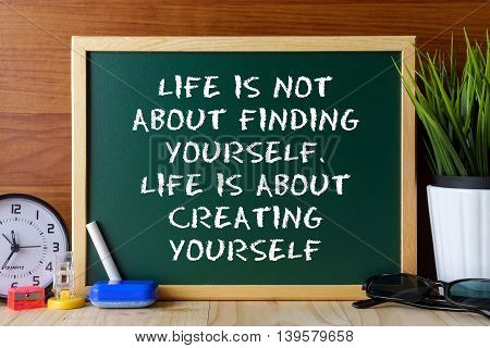 Word Quote Life Is Not About Finding Yourself,life Is About Creating Yourself Written On Green Chalk