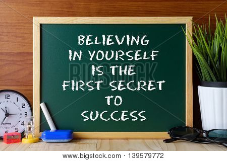 Word Quote Believing In Yourself Is The First Secret To Success Written On Green Chalk Board On Wood