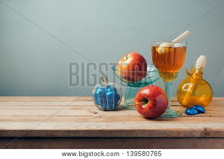 Jewish holiday Rosh Hashana celebration with honey apples and chocolate on wooden table