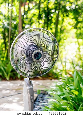 The electric table fan in the garden