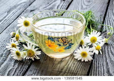 Herbal tea with chamomile (Matricaria chamomilla). Chamomile - a medicinal plant. Used in herbal medicine cosmetics food industry. Selective focus
