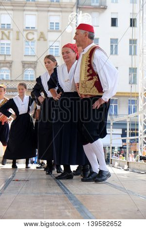 ZAGREB, CROATIA - JULY 23: Members of folk group from Osojnik, Croatia  during the 50th International Folklore Festival in center of Zagreb, Croatia on July 23, 2016