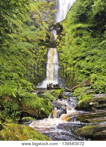 A View of Pistyll Rhaeadr Waterfall and its Natural Arch in Powys Wales