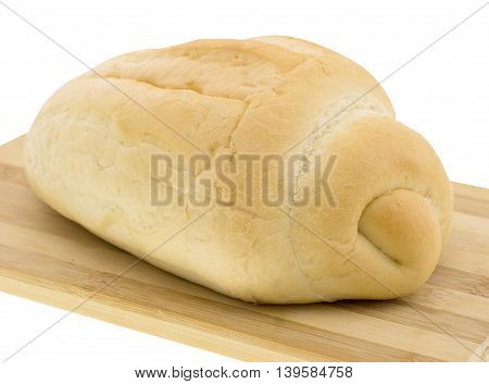 cutting wheat bread on a white background