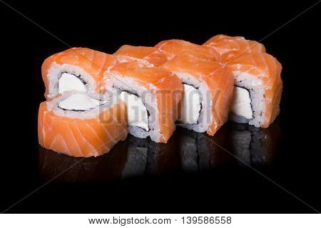Japanese rolls isolated on black background with reflection