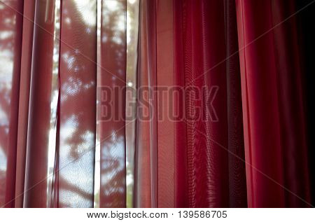 Curtain or drapes red background inside the house
