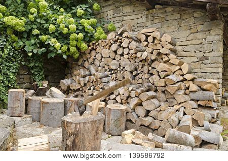 Stack of firewood outside in the summer