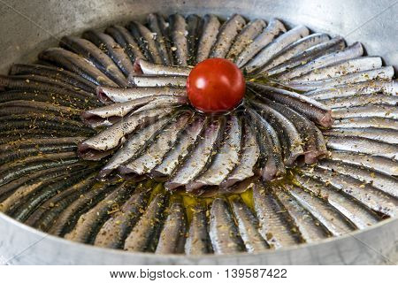 Sardines in a pan, ready for cooking