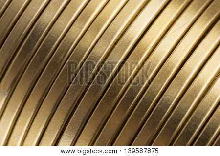 Corrugated or ribbed gold metal texture or background