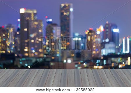 Opening wooden floor, Blurred lights big city, abstract bokeh background