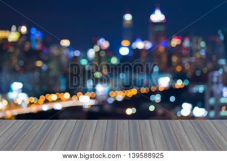 Opening wooden floor, Blurred lights night view, city downtown, abstract background