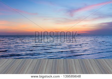 Opening wooden floor, Sunset over sea coast with beautiful sky background