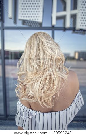 Back shot of woman with blonde hair