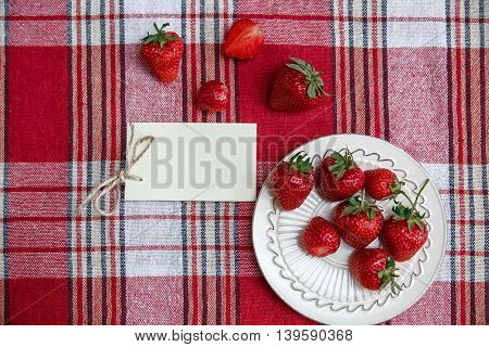 Red Fresh Strawberries  on the Ceramic Plate,on the Check Tablecloth.