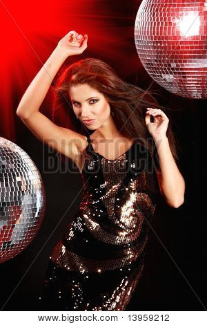 sexy girl dancing over mirror ball background