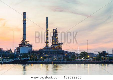Oil refinery riverside with sunrise sky background, Bangkok Thailand