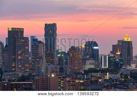 City central business office building with dramatic sunset sky background