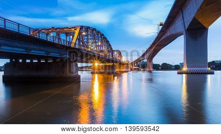 Under the Bridge over the Chao Phraya river in Bangkok, Thailand at twilght