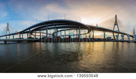 Panorama Twin suspension bridge connect to highway interchange river front, Bangkok Thailand