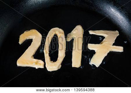 Butter In Shape Of Number 2017 On Hot Pan - Close Up Top View