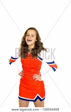 Teen Cheerleader Wearing  Orthodontic Braces Hands On Hips Happy Smiling