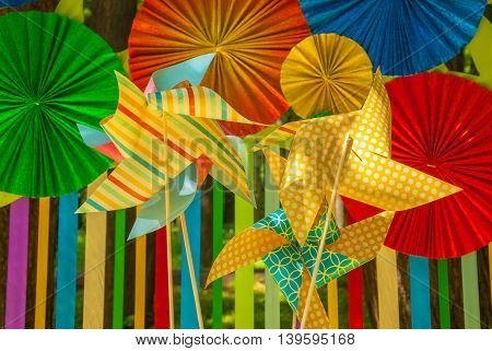 Origami of bright colored paper - umbrellas and turntables