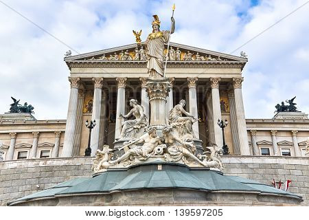 Statue of Athena the greek goddess of wisdom in front of the Austrian Parliament Building in Vienna