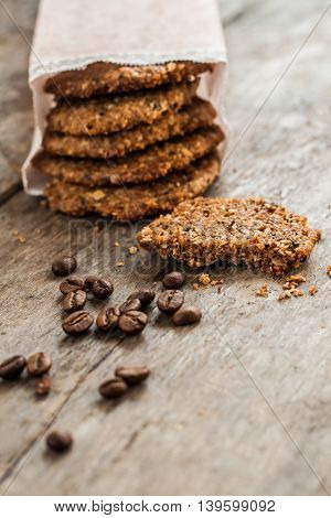 Coffee Cookies In A Paper Bag And Scattered On The Table
