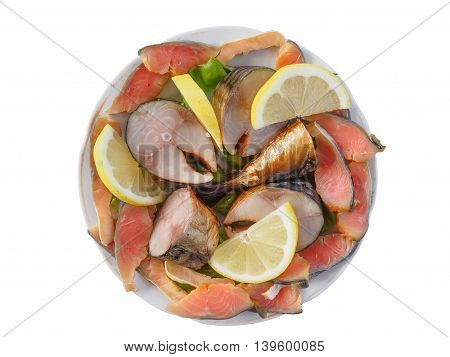 Plate of cold-smoked salmon and mackerel with lemon and lettuce