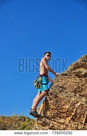 Climber Climbing With Carbines