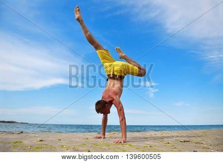 Yoga Man Standing On Hands