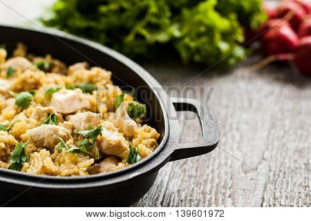 Pilaf Rice-curry With Chicken And Salad In The Form Of Iron