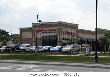 SHOREWOOD, ILLINOIS / UNITED STATES - AUGUST 30, 2015: One may purchase tires, and have service performed on one's vehicle, at the Firestone Complete Auto Care store in Shorewood.