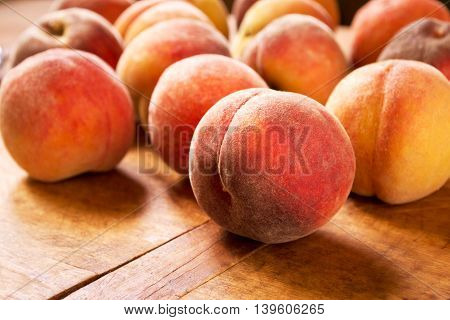 Fresh peaches on a wooden table, selective focus