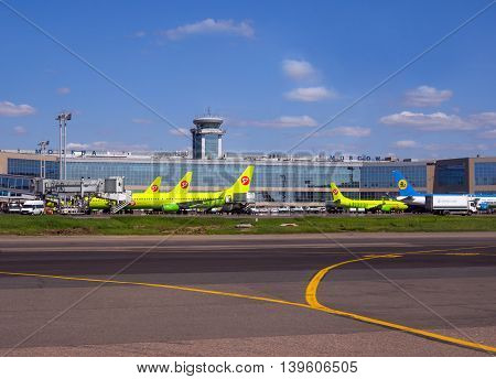 Moscow, Russia - June 01, 2016, View of the building of the passenger terminal of Domodedovo Airport and planes facing it