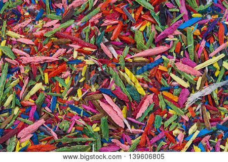 Horizontal top view of colorful remains on pencil sharpening