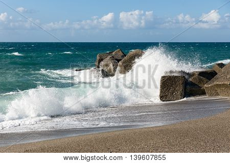 Breaking waves at beach of Sicily Italy