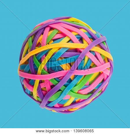 Rubber elastic band ball on light blue background