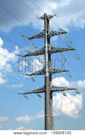 High-voltage power line grey metal prop with many wires vertical view closeup