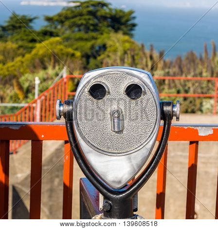 binoculars at the golden gate bridge are formed like a face with nose eyes and mouth