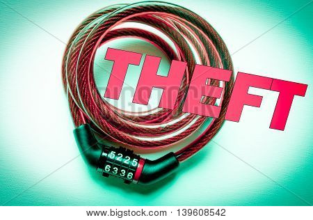 Theft text on red bicycle lock. color background