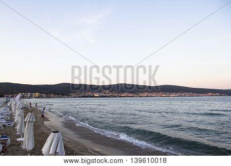 empty beach the sand and the dark sky