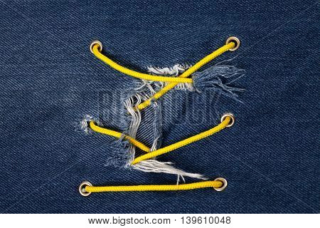 Blue jean with hole and crisscross lacing