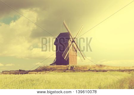 the windmill in beautiful morning; toned photo