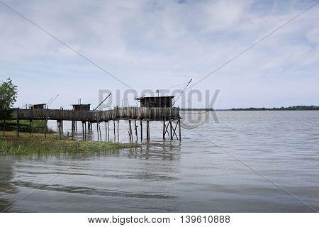 Fisherman's hut facing a river near Bordeaux