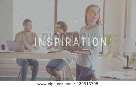 Inspire yourself. Inspirational typographic message for inspiration with image of young smiling businesswoman holding laptop in a background
