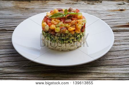 Homemade Crab Meat Salad with Heirloom Tomato Salsa and Sesame Seeds Chopped Avocado on Wood Background/ Selective Focus