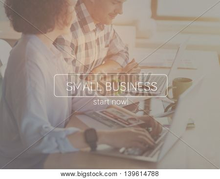 Digitalization. Inspirational typographic quote is small business with cropped image of businesspeople using laptops in a background